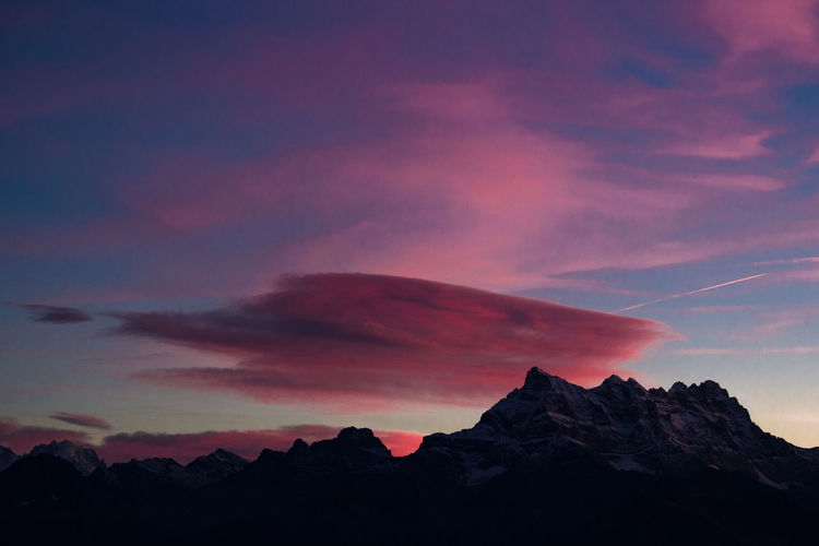 Low Angle View Of Mountains Against Sky During Sunset