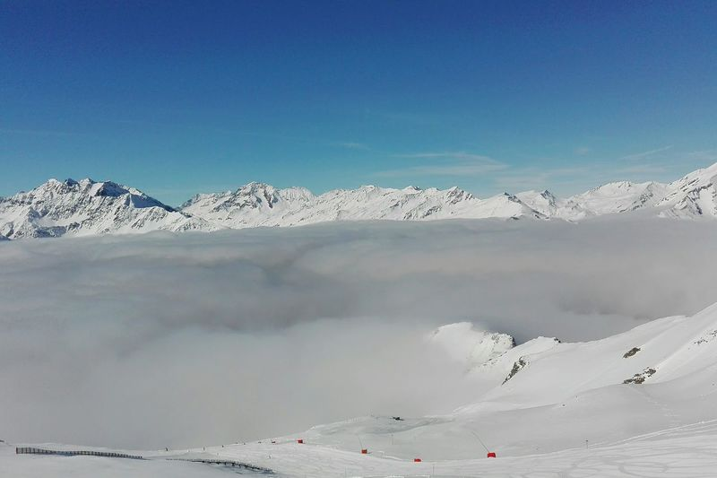 Clouds Cloud - Sky Clouds And Sky Cloudy Day Clouds Clouds And Sky Cloud Covered Snow Mountain Pastel Colored Cold Temperature Sky Landscape Snowcapped Mountain Winter Ski Track Snow Covered Deep Snow Mountain Range Rocky Mountains Snowcapped