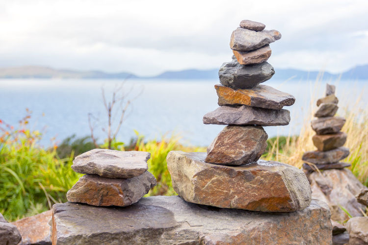 Pile of stones in front of the beach Solid Rock Stack Balance Rock - Object Stone - Object Focus On Foreground Nature Zen-like Water No People Sky Day Stone Tranquility Close-up Sea Outdoors Scenics - Nature Pebble