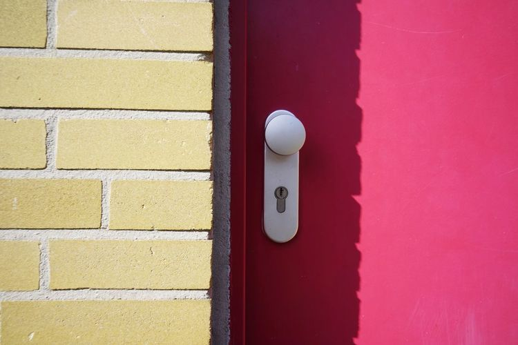 Sunlight Falling On Closed Pink House Door