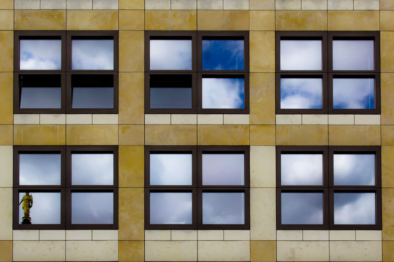 Berlin's Windows. FILIPPI GIULIA PHOTOGRAPHY. Architecture Berlin Blue Building Exterior Canon City Clouds Colors Day Detail Germany Mirror No People Pattern Photographer Photography Reflection Shade Sky Statue Street Street Photography Transparent Window Yellow