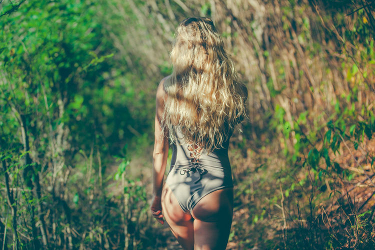 Walk through the jungle Blond Hair Hair Jungle Leisure Activity Lifestyles Long Hair Outdoors Plant Real People Rear View Three Quarter Length Tree Women Urban Fashion Jungle EyeEmNewHere Capture Tomorrow