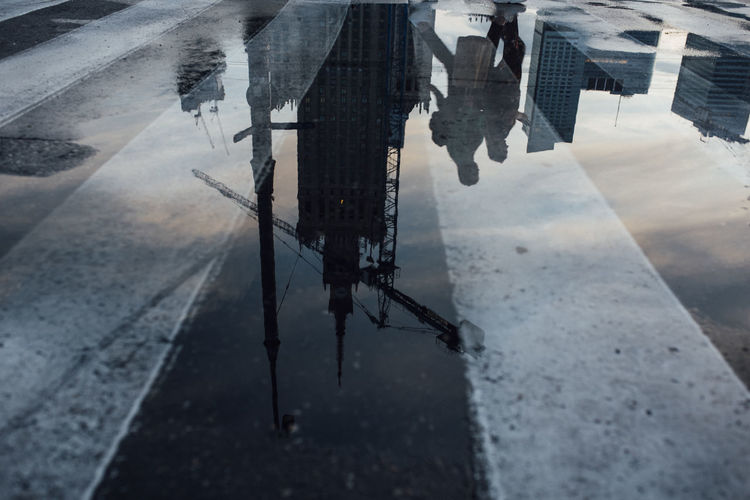 High angle view of puddle on street during rainy season