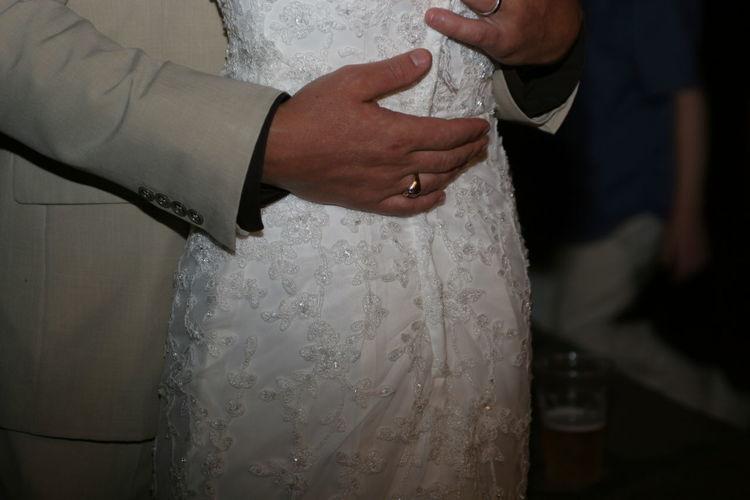 Close-Up Mid Section Of Newly Wed