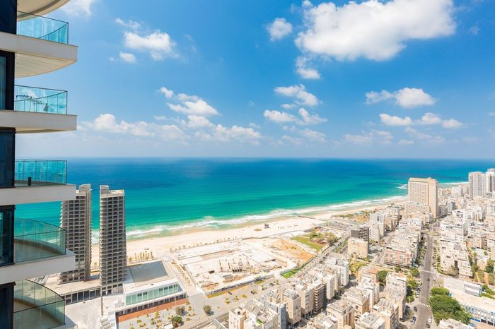 View Sea Horizon Over Water Sky Water Architecture Cloud - Sky Scenics Building Exterior Built Structure Day Outdoors Beach Nature Sunlight No People Blue Travel Destinations Beauty In Nature Cityscape