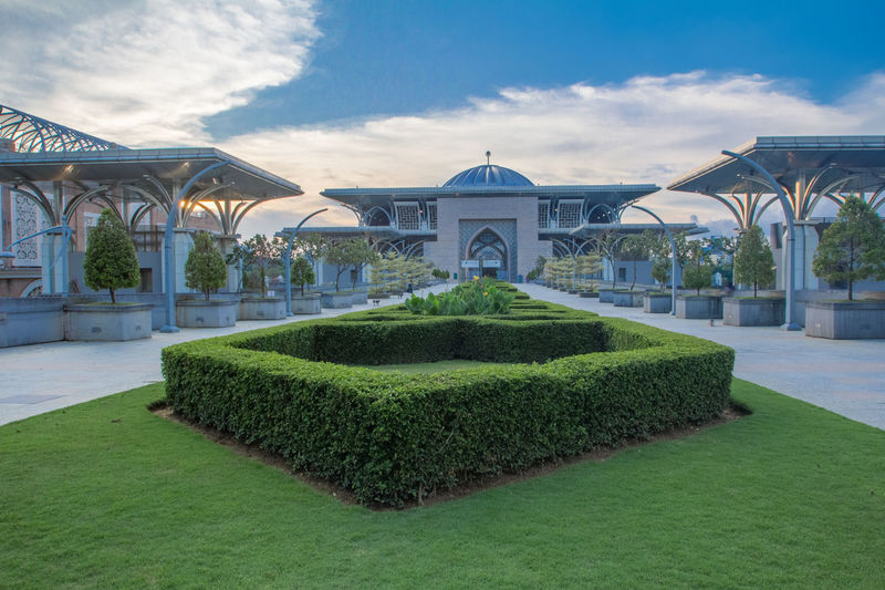 Mosque Tuanku Mizan Zainal Abidin on Blue Hour Arch Architecture Built Structure Cloud - Sky Day Grass Nature No People Outdoors Sky Topiary