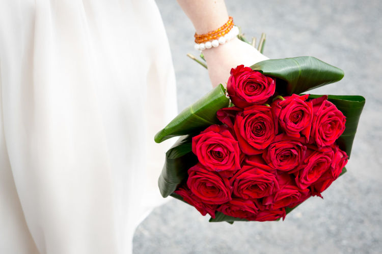 Beauty In Nature Bouquet Bride Celebration Close-up Flower Flower Head Fragility Gift Holding Human Body Part Human Hand Indoors  Life Events Lifestyles Love Midsection Nature One Person Real People Red Rose - Flower Standing Wedding Women