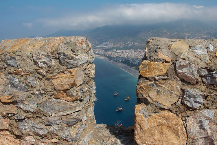 Water Solid Rock Rock - Object Nature Scenics - Nature Beauty In Nature Rock Formation No People Day Tranquil Scene Tranquility Mountain Sky Cloud - Sky Land Outdoors Non-urban Scene Mountain Range Eroded Sea Travel Alanya Turkey