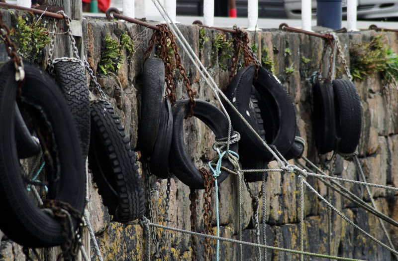 Abandoned tires against the wall