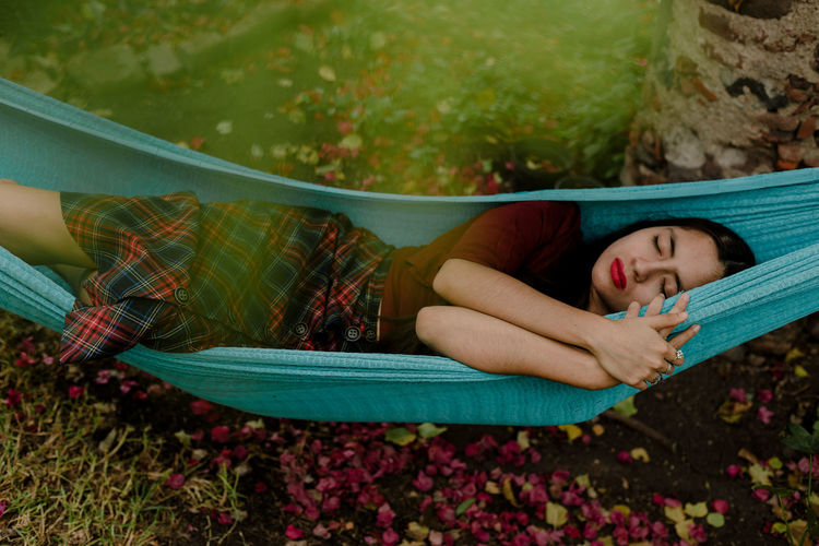 Woman lying down on hammock