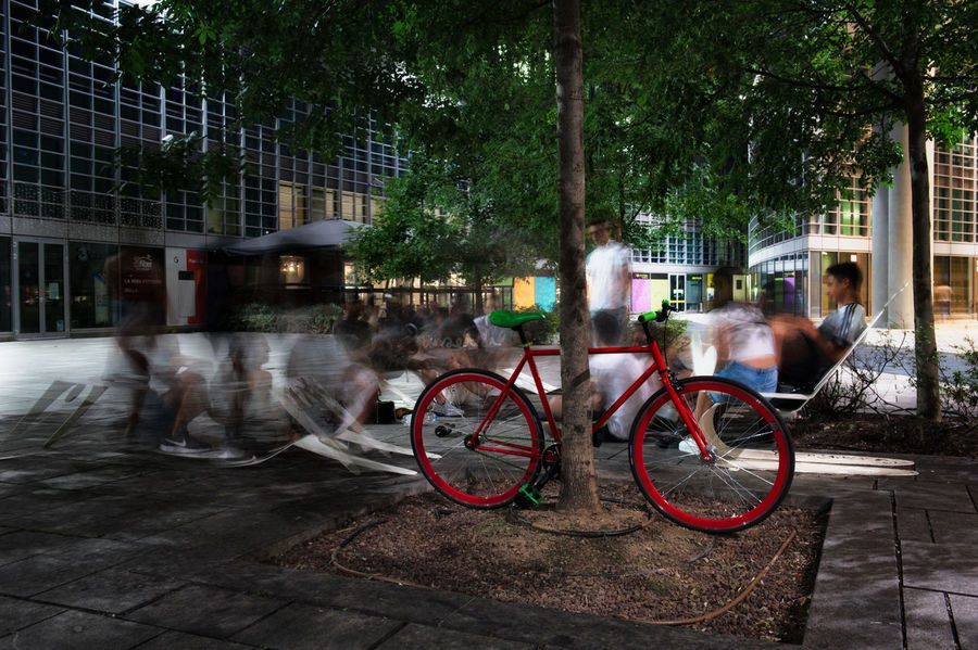 Architecture Bicycle Blurred Motion Building Exterior Built Structure City Day Incidental People Land Vehicle Men Mode Of Transportation Motion Nature Outdoors People Plant Real People Street Transportation Tree