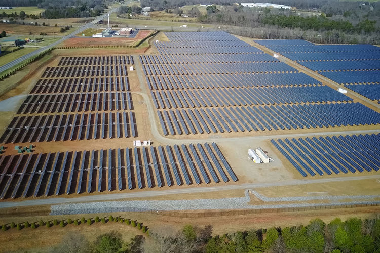 solar panels High Angle View No People Day Nature Architecture Landscape Outdoors Built Structure Water Environment Pattern Plant Tranquility Building Exterior Field Pool Tranquil Scene Renewable Energy Blue Swimming Pool Solar Panels