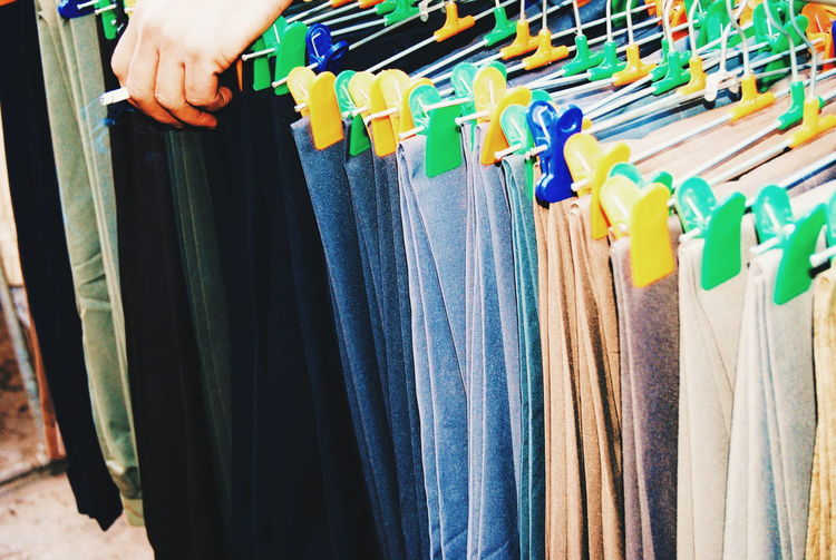 High Angle View Of Various Clothing Hanging At Store