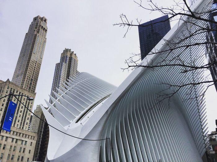 Directly below shot of modern buildings against sky