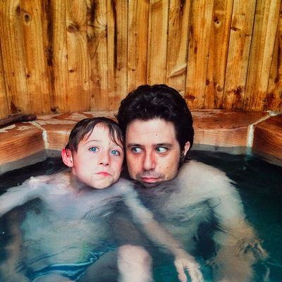 Father and son in a wooden hot tub Two People Looking At Camera Portrait Front View Boys Togetherness Males  outdoors Hot Tub in Leisure Activity Son Making A Face Bonding Friendship Men Water Adult People Young Adult Day