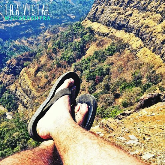 Life is a thrill when you step over the edge... Looking over the rough terrains of the Deccan Ghats Real People Lifestyles One Person Shoe Men Leisure Activity Low Section Water Day Human Body Part Nature Human Leg Outdoors Close-up People Mountain Range Sky Mountain Peak Saumik Jor Daytime Scenics Beauty In Nature No People Green Color Backgrounds
