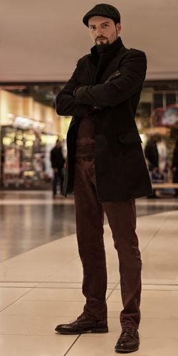 Portrait Of Man Standing On Tiled Floor