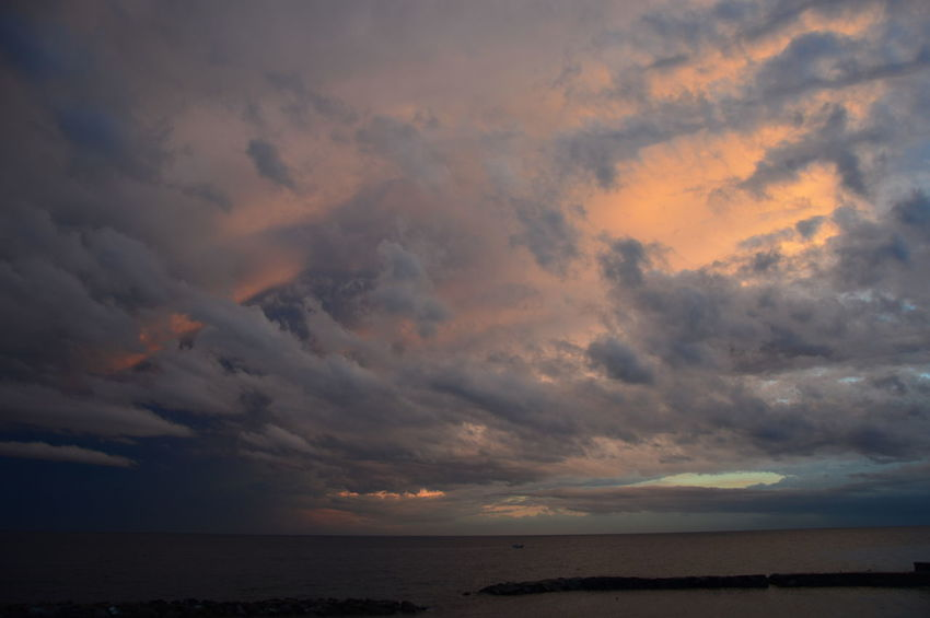 Sunset on the Mediterranean sea from the viewpoint of italy, with cloudy sky Mediterranean Sea Mediterranean Seascape Reflection Réflexion Sunset On The Mediterranean Sea Sunset On The Mediterranean Sea From The Viewpoint Of Italy, With Cloudy Sky Vivid Colours  Beauty In Nature Cloud - Sky Cloudscape Cloudy Sky Background Horizon Horizon Over Water Motley Multicolored Particolored Reflections In The Water Seascape Sky Stained Sundown Sunset Tranquil Scene Tranquility Water