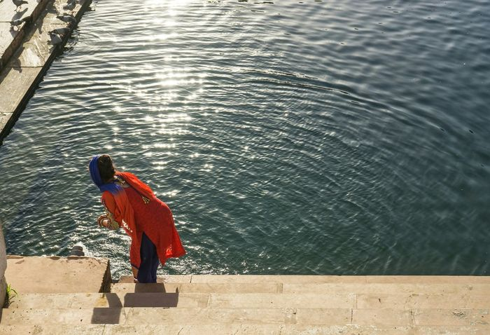 Morning Blessing Pushkar Lake India Morning Rituals Ritual One Woman Only Woman Hindu Rajasthan Red Color Palette Colour Of Life People And Places