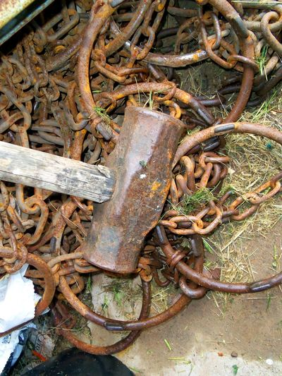 Abandoned Bad Condition Chains Close-up Complexity Damaged Day Hammer And Chains Industry Metal Metallic No People Obsolete Old Tools Outdoors Run-down Rusty Scrap Metal Sledge Hammer