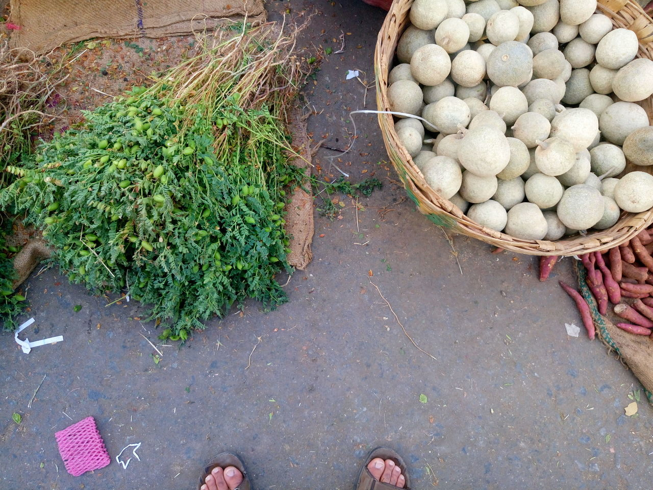vegetable, market, for sale, large group of objects, high angle view, abundance, retail, outdoors, day, choice, freshness, variation, food, healthy eating, real people, men, low section, one person, people