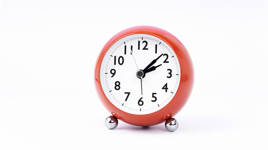 Close-up of clock on white background