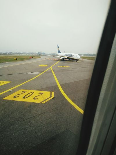 Airplane Airport Runway Aerospace Industry Air Vehicle Airport Water Yellow Wet Sky
