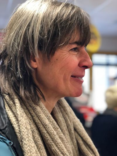 Side view of smiling mature woman looking away