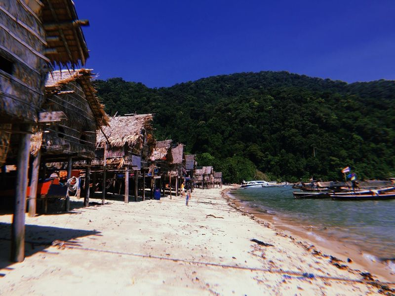 Morgan Village Morganvillage Village Island Thailand Surin Islands Andaman Sea Tree Large Group Of People Outdoors Real People Nature Clear Sky Day Mountain Beauty In Nature Water Sky