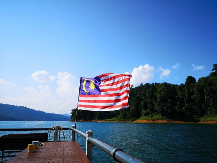 Kenyir Lake Kenyir Lake Resort Malaysia Truly Asia Malaysia Lake View Lake Lakeside Water Waterfall Water_collection Outdoors Outdoor Photography Forest Forest Photography Forestwalk Sky Patriotism Flag Nature Cloud - Sky Day Beauty In Nature No People Mountain Transportation Blue Nautical Vessel River Scenics - Nature Mode Of Transportation Freedom Wind Independence National Icon