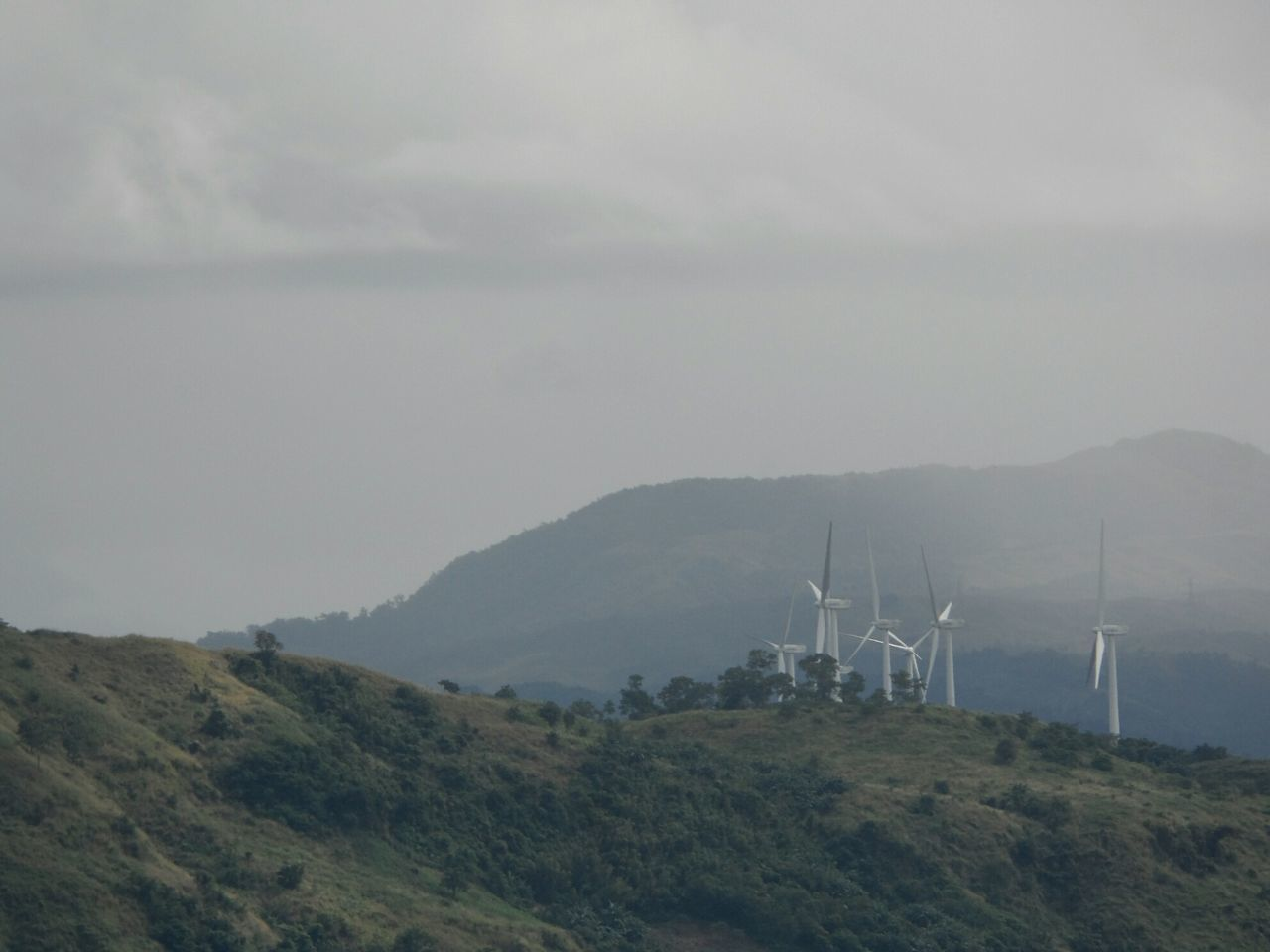 wind turbine, wind power, mountain, alternative energy, renewable energy, fuel and power generation, environmental conservation, nature, no people, landscape, windmill, mountain range, tranquil scene, day, beauty in nature, sky, tranquility, industrial windmill, outdoors, scenics, technology