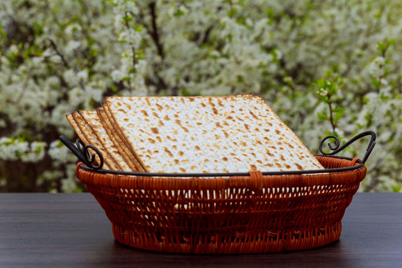 Crackers In Wicker Basket On Table Outdoors