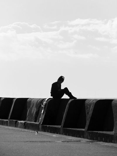 Beach Day Beach Life Black & White Blackandwhite Photography Casual Clothing Cloud - Sky Day Full Length Leisure Activity Lifestyles Outdoors Person Promenade Relaxation Relaxing Side View Silhouette Sitting Sky Watching The Sunset Watching The Waves Watching The World Go By