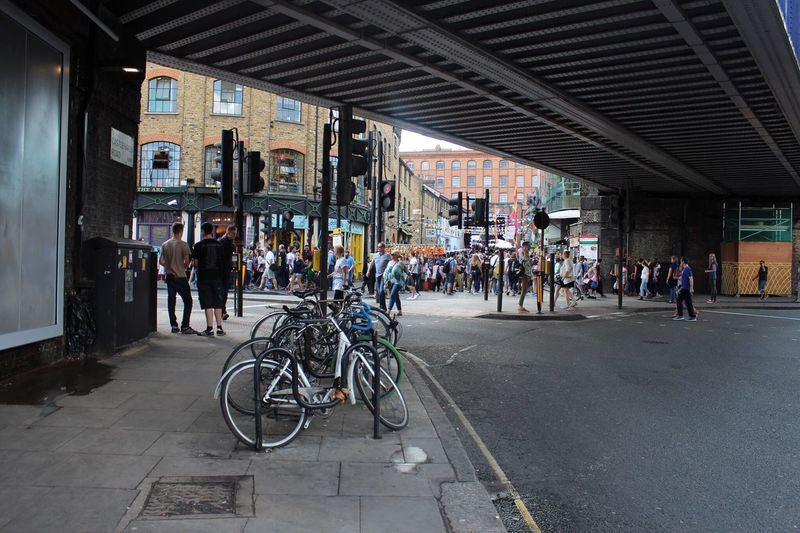 Bicycles Parked Under Elevated Road