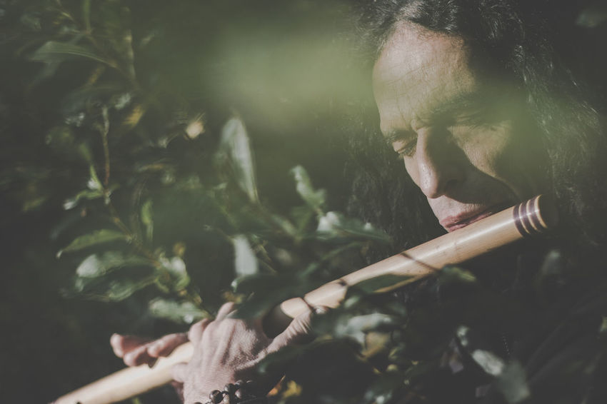 Artist Man Music Nature Activity Adult Bad Habit Close Up Close-up Day Ethnic Ethnic Music Ethnic Tools Forest Headshot Holding Human Body Part Human Hand Leisure Activity Lifestyles Men Musician Nature One Person Outdoors Plant Playing Real People Selective Focus Smoke - Physical Structure