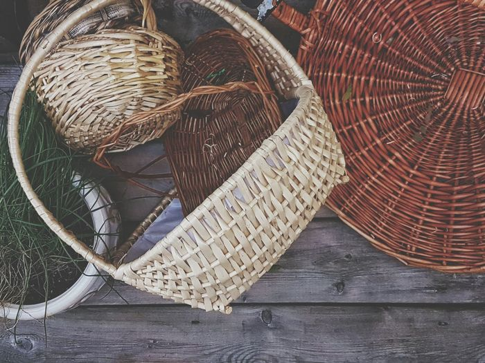 High Angle View Of Wicker Baskets On Wooden Table