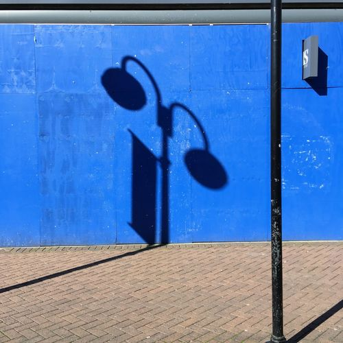 Wall Blue Building Exterior Built Structure Day Door Lamp No People Outdoors Shadow