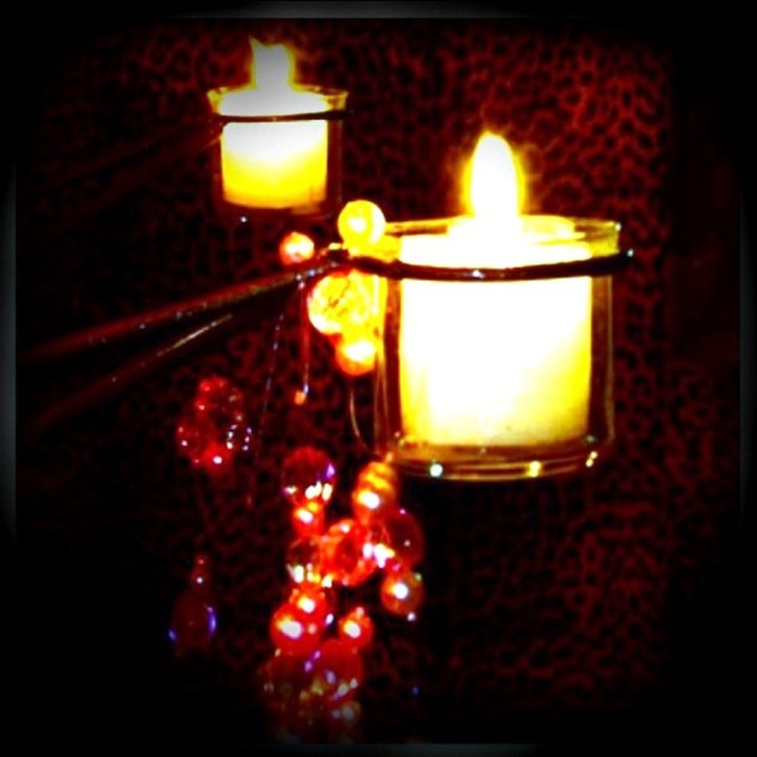 illuminated, lighting equipment, glowing, candle, lit, indoors, flame, burning, night, electricity, decoration, fire - natural phenomenon, close-up, light - natural phenomenon, heat - temperature, light bulb, electric light, lantern, candlelight, darkroom