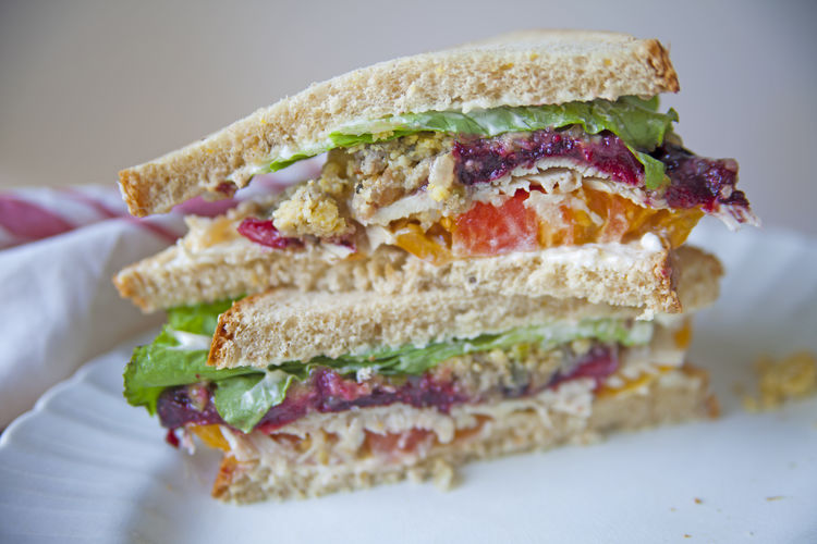 Turkey and stuffing sandwich Food Sandwich Close-up Freshness Ready-to-eat Bread Healthy Eating Indoors  Vegetable Studio Shot Plate Snack Turkey Thanksgiving Leftovers Cranberry Sauce  Colorful Lettuce Stuffing Delicious Messy Natural Light Copy Space Room For Text Stacked
