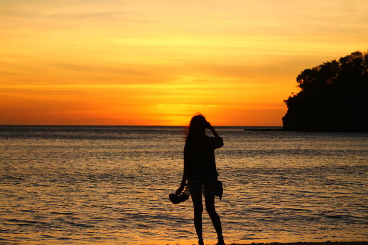 Sunset Silhouette One Woman Only Sunset Silhouette Of A Woman Woman Sillouette Sea One Person Beach Sky People Horizon Over Water Outdoors Only Women Vacations Woman Watching The Sunset Full Length Standing Social Issues Beauty In Nature One Young Woman Only Nature Purist No Edit No Filter Purist In Photography Long Goodbye