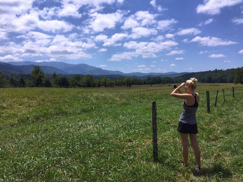 Cades Cove Tennessee Great Smoky Mountains  Sky Cloud - Sky Nature Standing One Person Full Length Field Mountains Real People Casual Clothing Growth Outdoors Beauty In Nature Scenics Lifestyles Young Women Leisure Activity Landscape Day Taking Photos The Week On EyeEm EyeEm Best Shots