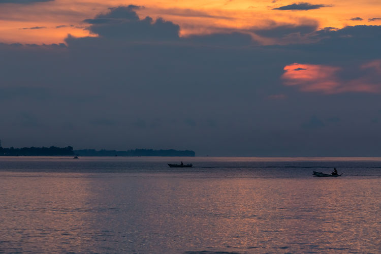 Sunset fishing EyeEmNewHere INDONESIA Beauty In Nature Dusk Fisherman Fishing Boat Horizon Over Water Lombok Nature Outdoors Sea Silhouette Sky Sunset Tranquility Transportation Water Waterfront