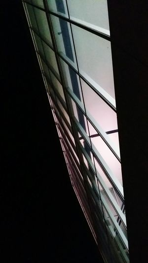 Light through window Light Through The Window Night Light In Darkness Geometric Shape Office Building Rectangle Architectural Detail Geometry