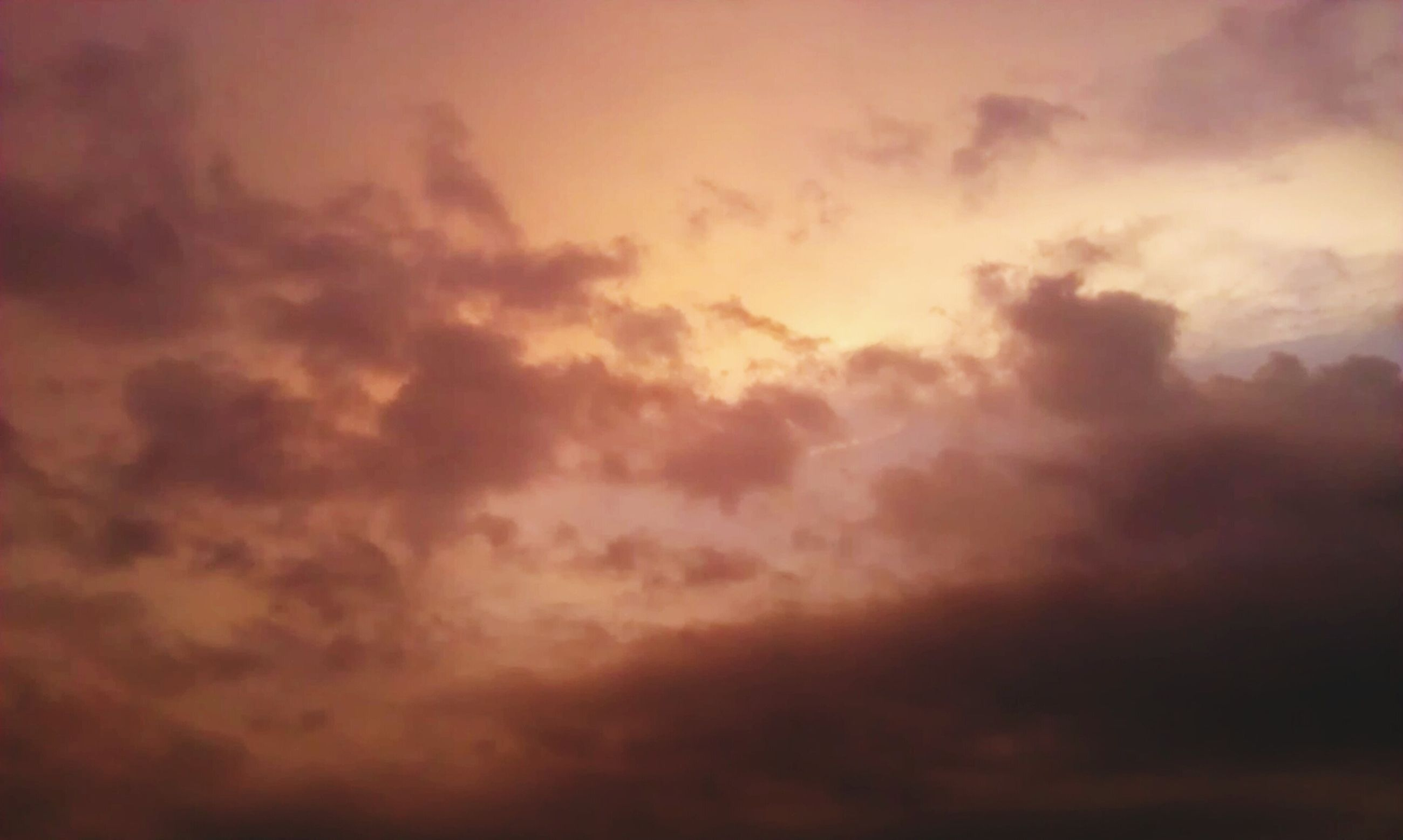 sky, cloud - sky, sky only, beauty in nature, low angle view, scenics, cloudy, cloudscape, tranquility, tranquil scene, nature, weather, backgrounds, sunset, full frame, overcast, idyllic, dramatic sky, cloud, majestic