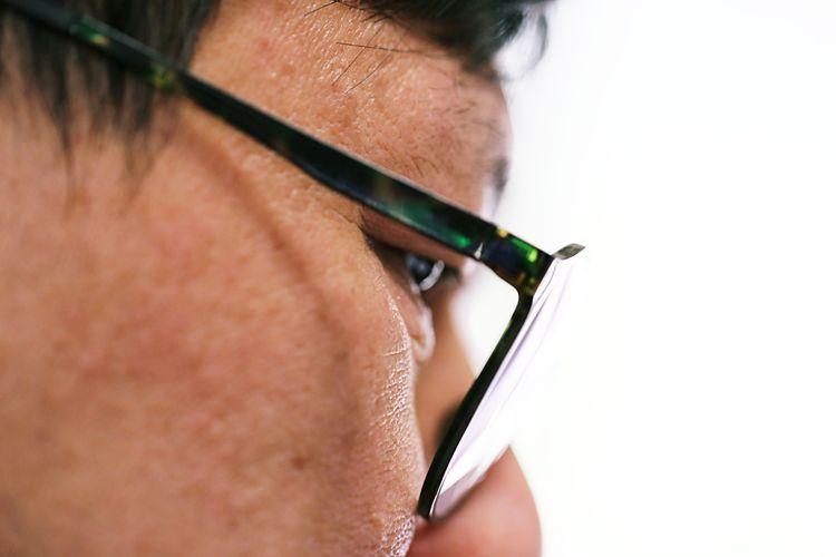 Midsection of man wearing eyeglasses