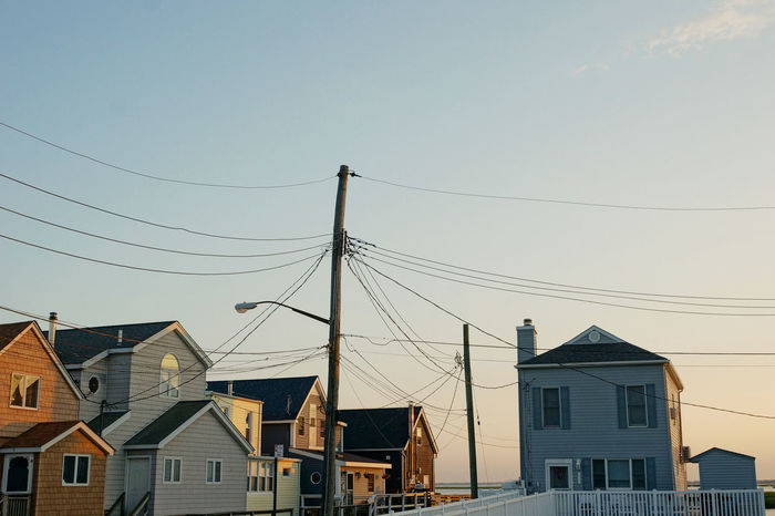 Small town America Architecture Blue Building Building Exterior Built Structure Cable Evening Evening Light Home Hometown Idyllic Idyllic City New York City Power Line  Power Supply Residential Building Residential District Sky Small Town Small Town USA Street Light Suburb Summer Town Wooden Building