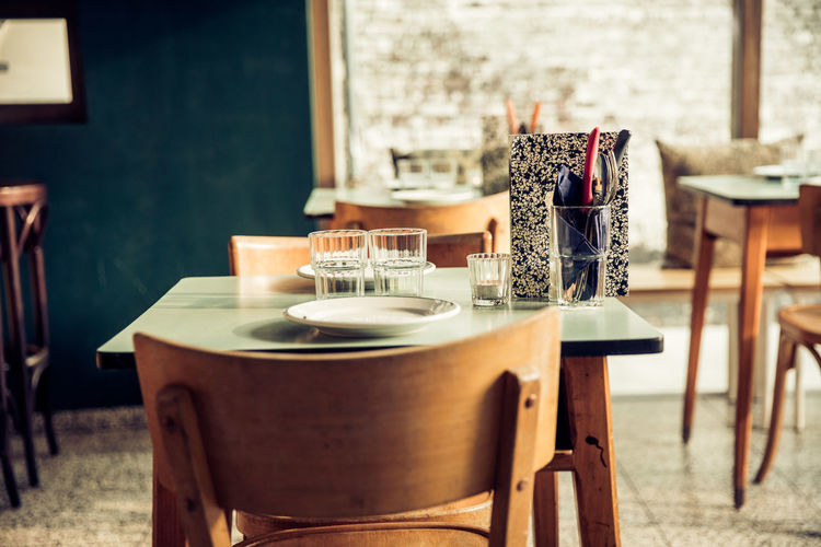 Empty chairs and table in cafe