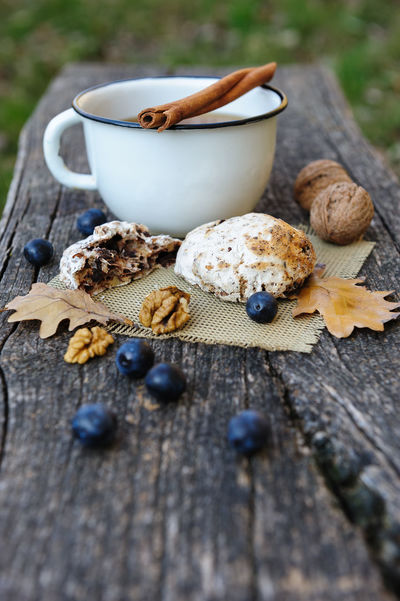 Autumn still life with cup of tea, berries, cookies and leaves on old cracked wooden plank Autumn Berries Cinnamon Roll  Fall Beauty Tea Beries Cinnamon Close-up Cookes Cup Day Fall Food Food And Drink Freshness Healthy Eating Leaves Mug Nature No People Still Life Tea Cup Wood - Material