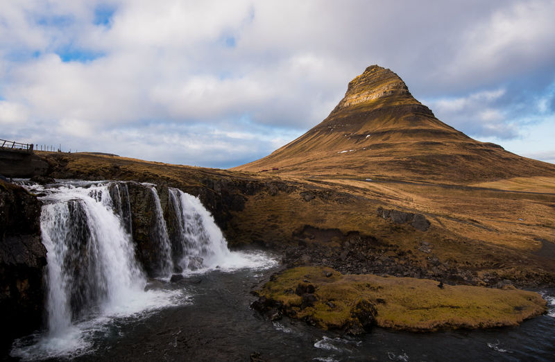 The kirkjufell mountain and the kirkjufellfoss waterfall in iceland