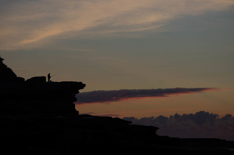 Beauty In Nature Cloud - Sky Idyllic Land Mountain Nature No People Non-urban Scene Orange Color Outdoors Rock Rock - Object Rock Formation Scenics - Nature Silhouette Sky Solid Sunset Tranquil Scene Tranquility